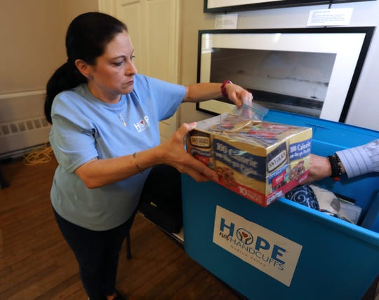 """Cathy Kennedy of Congers shows supplies used in the """"Hope Not Handcuffs"""" program that trains police departments to help people seeking opioid addiction treatment May 1, 2019. She is an """"angel"""" volunteer with the program."""