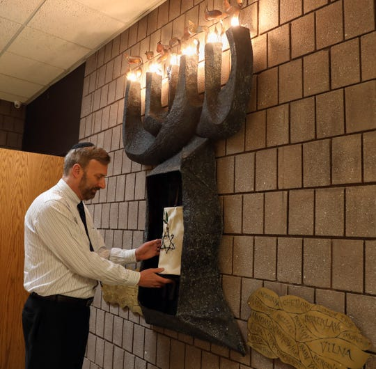 Rabbi Daniel Pernick shows the new Holocaust Torah and memorial at Beth Am Temple in Pearl River May 1, 2019.