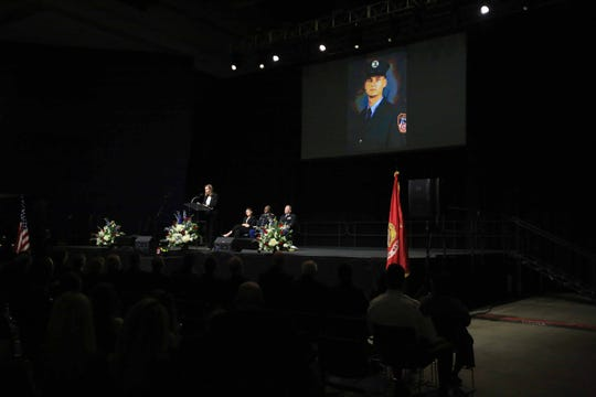Shannon, wife of Marine Staff Sgt.Christopher Slutman, talks about her husband during a public memorial held at the University of Delaware's Bob Carpenter Center on Wednesday.