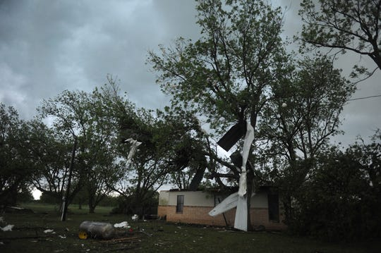 A tornado damaged houses and uprooted trees Tuesday, April 30, 2019, in Charlie, Texas.