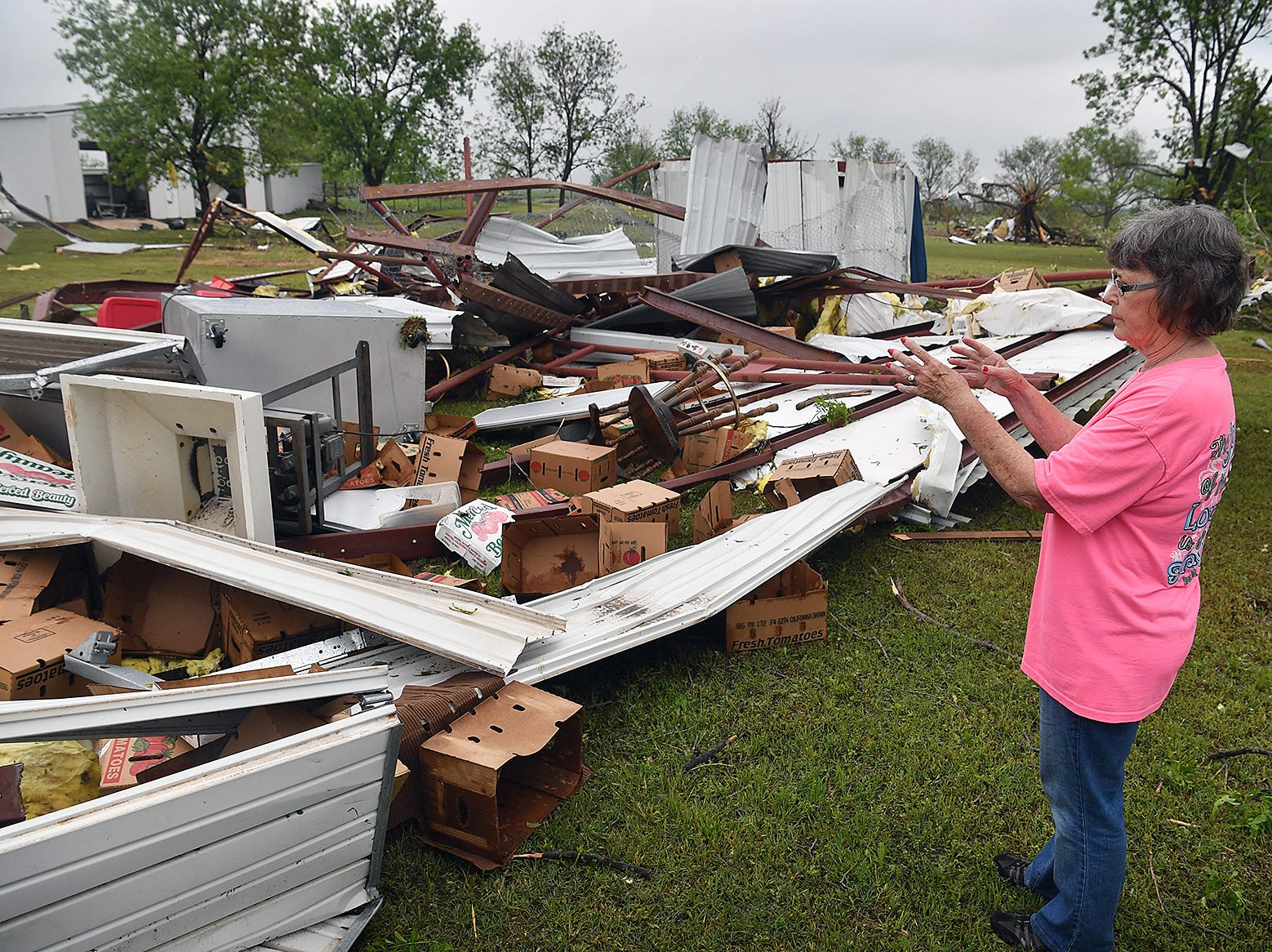 Toni Jetton describes some of the agriculture equipment that was destroyed when a tornado tore through Jetton Farms in Charlie, Texas Tuesday evening, April 30, 2019.