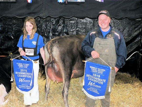 Hannah Nelson, Elkhorn and Noah Bilz,  Dorchester are happy with their Intermediate Jersey Championship placing. After meeting at a Jr. Holstein meeting they bought a (then) calf together.