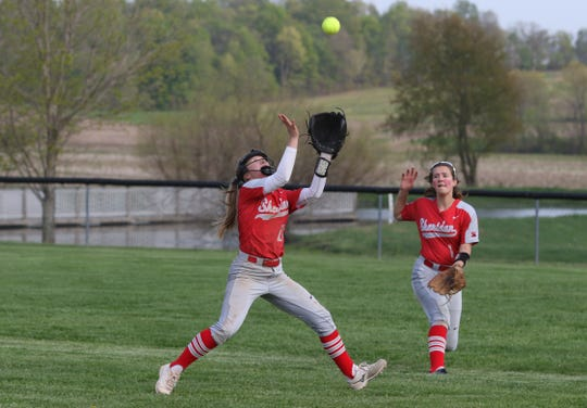 Sheridan's Abbie Mills chases down a pop up against Tri-Valley Tuesday afternoon in Thornville.