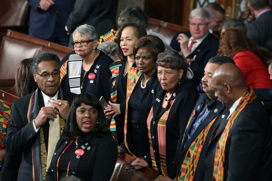 Members of Congressional Black Caucus wear black clothing and Kente cloth ahead of a State of the Union address in the chamber of the House of Representatives in Washington, D.C., on January 30, 2018.