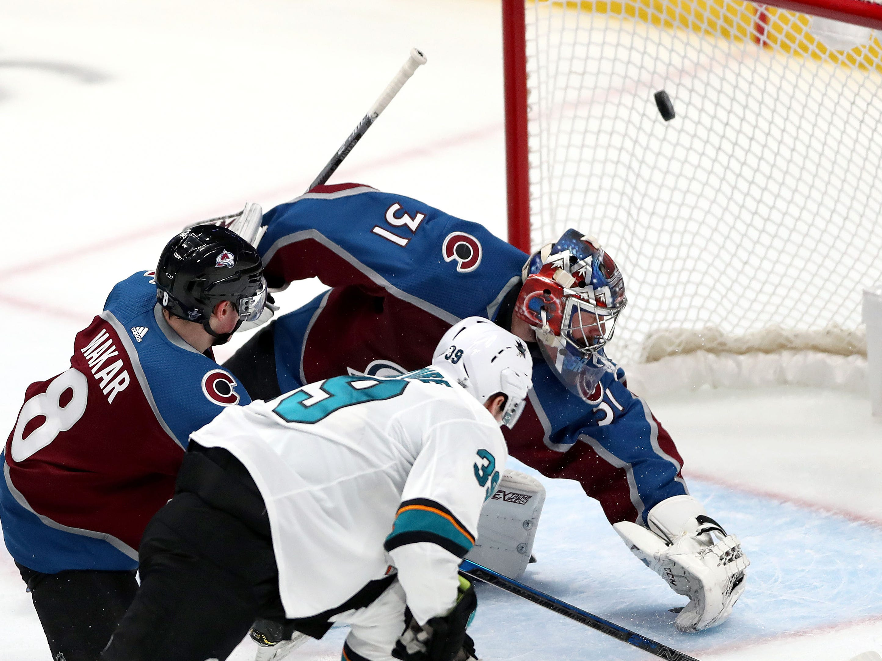 Second round: Sharks forward Logan Couture scores one of his three goals against the Avalanche in a 4-2 win in Game 3.