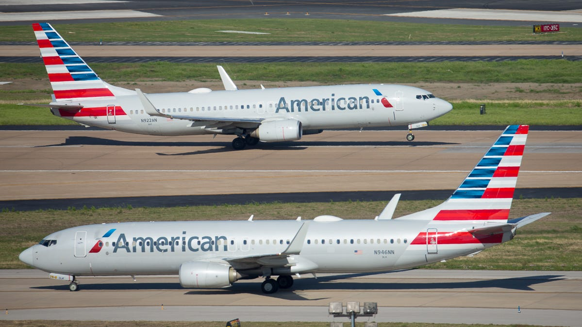 American Airlines Boeing 737-800 jets trade places at Dallas-Fort Worth International Airport in April 2019.