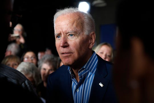Former Vice President and Democratic presidential candidate Joe Biden greets audience members during a rally, Wednesday, May 1, 2019, in Iowa City, Iowa.
