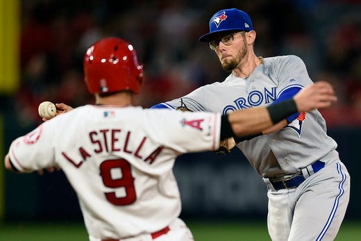 April 30: Toronto Blue Jays second baseman Eric Sogard throws to first base after forcing out the Los Angeles Angels' Tommy La Stella (9) during the second inning at Angel Stadium of Anaheim.