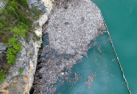 In this aerial photo taken on April 23, 2019, plastic bottles and other garbage float in the river Drina near Visegrad, eastern Bosnia-Herzegovina. Plastic bottles, rusty barrels and even old washing machines are among tons of garbage clogging rivers in Bosnia that were once famous for their emerald color and crystal clear waters adored by rafters and adventurers as well as fishermen.