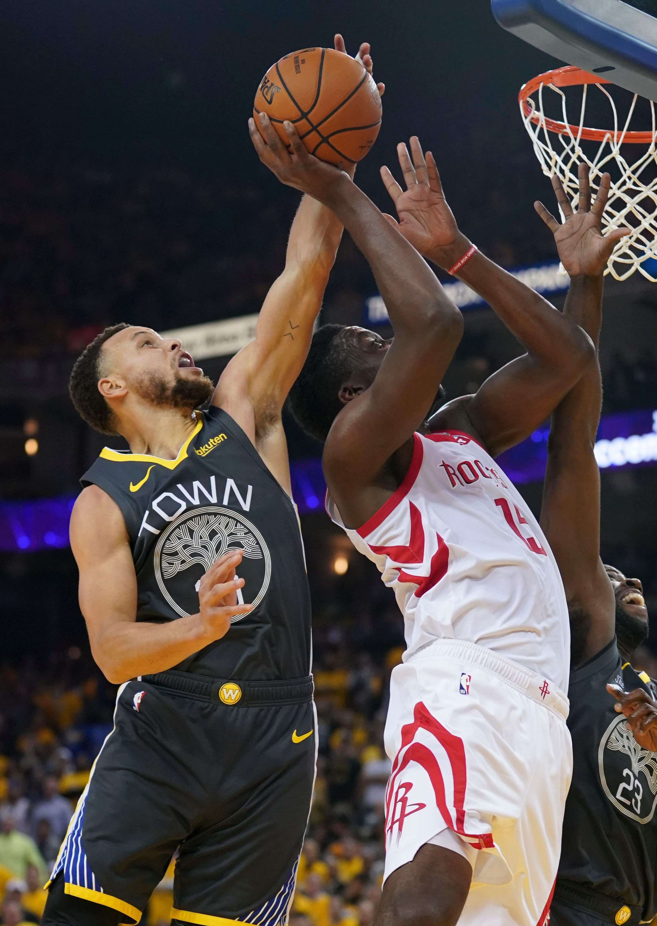 April 30: The Golden State Warriors' Stephen Curry blocks the shot of Houston Rockets center Clint Capela during the second quarter in Game 2.