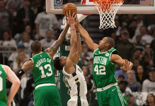 April 30: Celtics forward Marcus Morris (13) and center Al Horford (42) double-team Bucks forward Giannis Antetokounmpo (34)  during Milwaukee's 123-102 victory in Game 2.