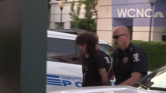 Trystan Andrew Terrell is taken into Charlotte police headquarters. Police identified the 22-year-old as the suspect of the UNC Charlotte shooting.