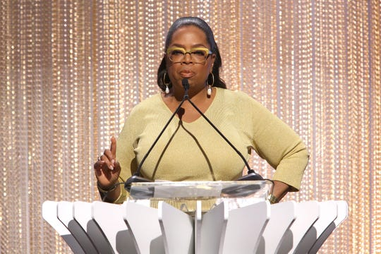 Oprah Winfrey accepts the Empowerment in Entertainment Award and talks about misogyny in the workplace at The Hollywood Reporter's luncheon Tuesday at Milk Studios.