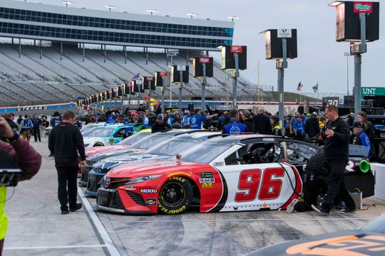 Teams prepare cars to qualify for the NASCAR Cup race at Texas Motor Speedway on March 29.