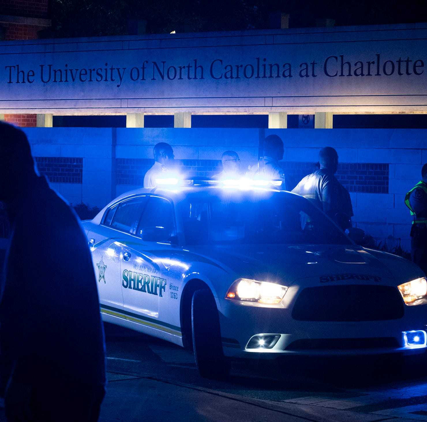 Police secure the main entrance to UNC Charlotte after a fatal campus shooting on Tuesday.