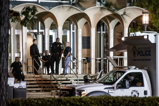 Charlotte-Mecklenburg law enforcement stand in front of the Kennedy building where a gunman killed two people and injured four students at UNC Charlotte. Campus police responded to the scene on Tuesday and apprehended a suspect, 22-year-old Trystan Andrew Terrell.