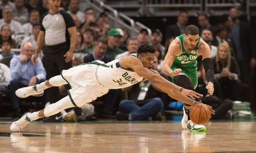 April 30: Bucks forward Giannis Antetokounmpo (34) dives for the loose ball in front of Celtics forward Jayson Tatum (0) during Game 2. Milwaukee roted Boston 123-102.