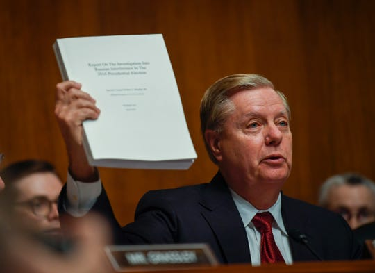 Senate Judiciary Committee Chairman Lindsey Graham holds the Mueller Report during opening statements.