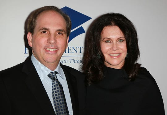 Former Los Angeles Rams owner and movie producer Chip Rosenbloom and his wife Kathleen attend a benefit for the Fulfillment Fund, a Los Angeles scholarship charity, in 2010.