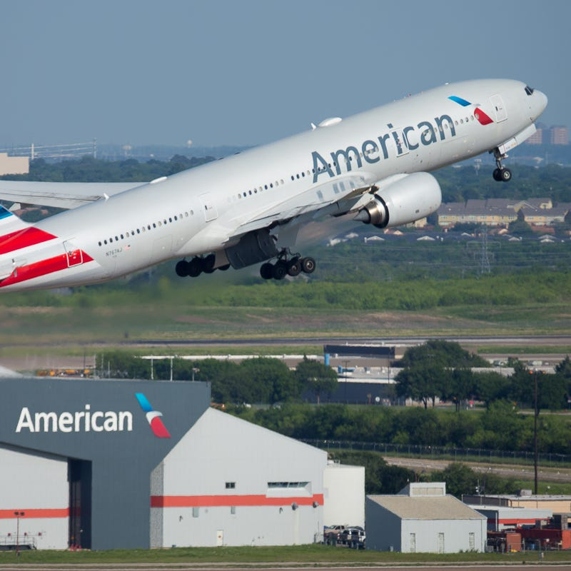 An American Airlines Boeing 777-300 takes off from Dallas-Fort Worth International Airport in April 2019.