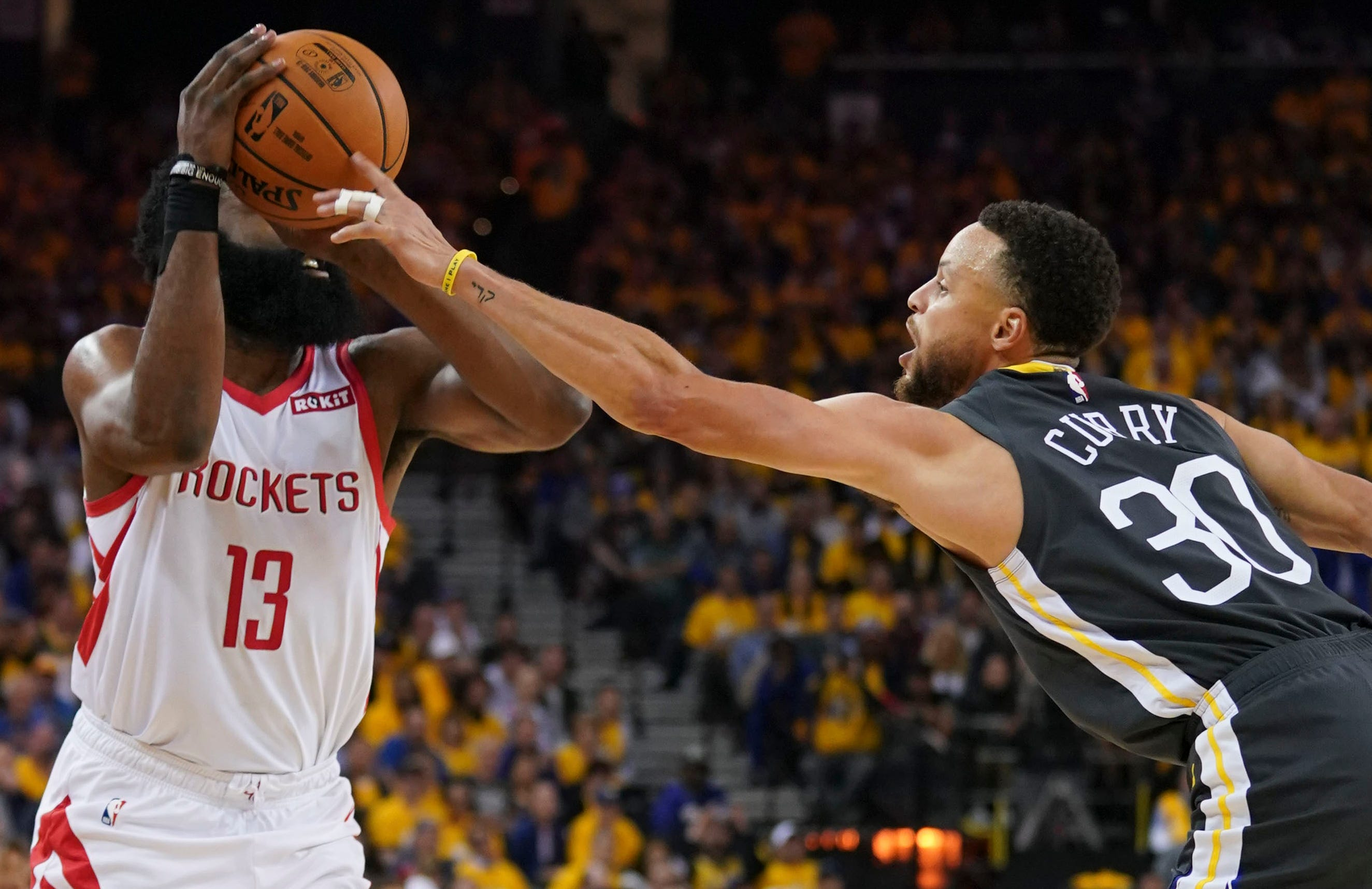 April 30: Golden State Warriors guard Stephen Curry blocks the shot of Houston Rockets guard James Harden during the second quarter in Game 2.