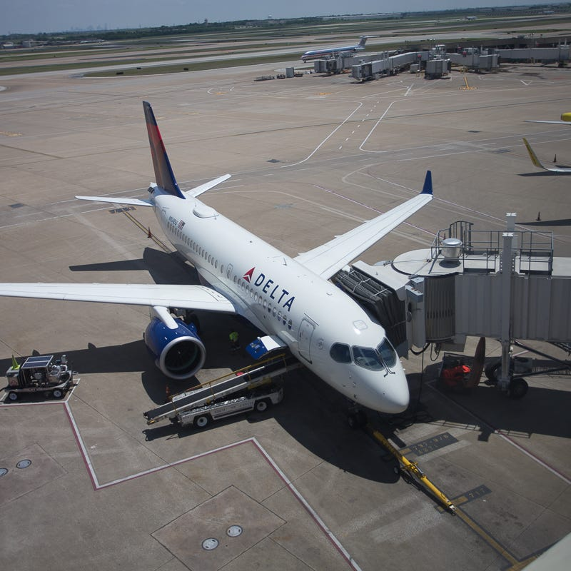 A Delta Air Lines Airbus A220 rests between flights at Dallas-Fort Worth International Airport in April 2019.