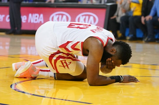 Rockets guard James Harden (13) reacts after getting poked in the eye in Game 2 of the second-round series.
