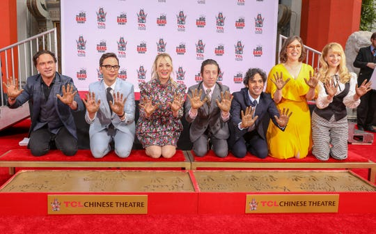 Stars of 'The Big Bang Theory' - Johnny Galecki, left, Jim Parsons, Kaley Cuoco, Simon Helberg, Kunal Nayyar, Mayim Bialik and Melissa Rauch - dressed up for a Hollywood honor, a TCAL Chinese Theatre ceremony, on Wednesday, a day after shooting the CBS comedy's series finale.