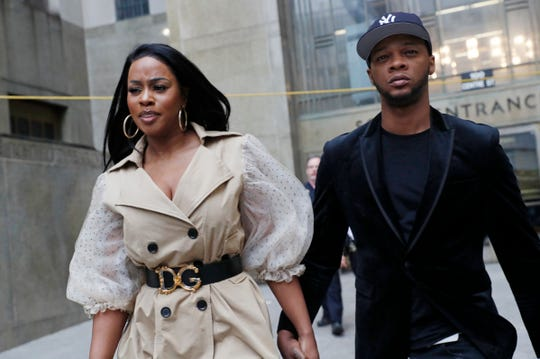 Rapper Remy Ma, left, leaves Manhattan Criminal Court, with her husband Papoose, also a rapper, after she was arraigned on a assault charge Wednesday, May 1, 2019, in New York.