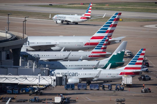 American Airlines jets fill Terminal A at Dallas-Fort Worth International Airport in April 2019.