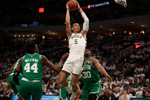 April 30: The Bucks' D.J. Wilson (5) slices through the lane for a basket against the Celtics during Game 2 in Milwaukee.