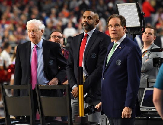 Grant Hill, center, with fellow CBS broadcasters Bill Raftery, left, and Jim Nantz prior to the 2019 NCAA men's basketball championship game between Virginia and Texas Tech.