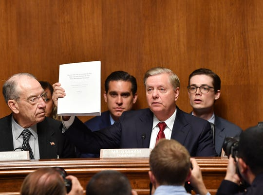 """US Senator Lindsey Graham holds the Mueller report as US Attorney General William Barr prepares to testify before the Senate Judiciary Committee on """"The Justice Department's Investigation of Russian Interference with the 2016 Presidential Election"""" on Capitol Hill in Washington, DC, on May 1,2019. (Photo by Nicholas Kamm / AFP)NICHOLAS KAMM/AFP/Getty Images ORG XMIT: Attorney ORIG FILE ID: AFP_1G317U"""