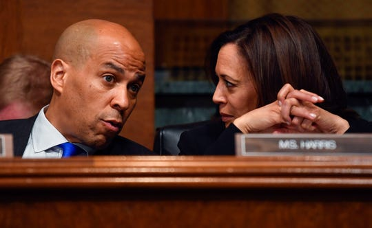 Sen.Cory Booker, left, and Sen. Kamala Harris speak as Attorney General William Barr testifies before the House Judiciary Committee hearing  May 1, 2019, about special counsel Robert Mueller's report and his handling of his investigation.