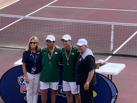 Menard tennis duo Justin Urbi (second left) and Anderson Dewitt (second right) won the Division III doubles title at the LHSAA tennis tournament April 27.