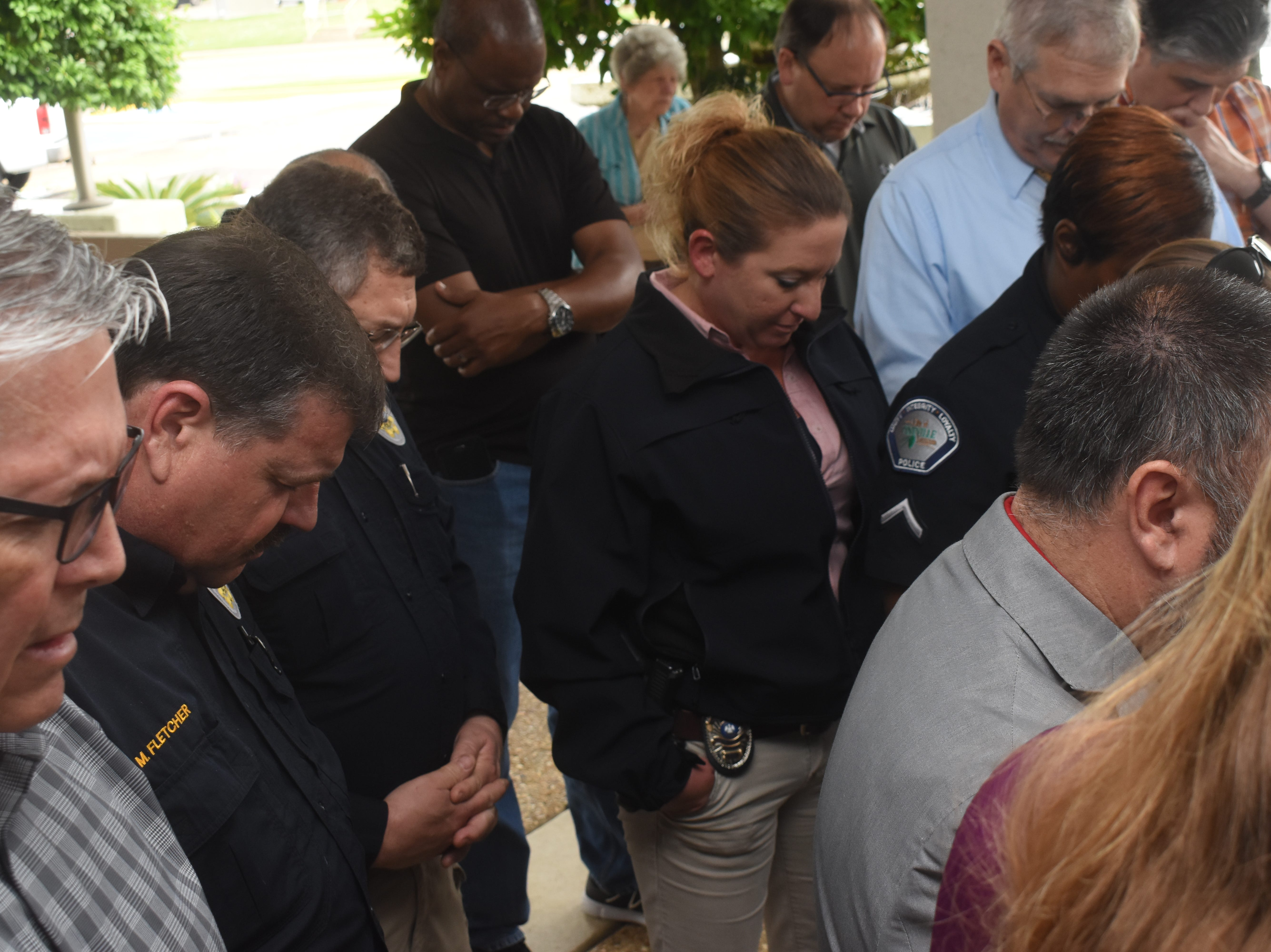 """Pineville citizens, city officials, law enforcement and emergency personnel gather at Pineville City Hall for the National Day of Prayer which is held on the first Thursday in May. People of all faiths are invited to prayer for the United States, elected officials, law enforcement and emergency personnel and the military. Pineville has observed the National Day of Prayer for over 20 years. Anyone attending the gathering could lead a prayer. The event ended with the singing of """"God Bless America."""""""