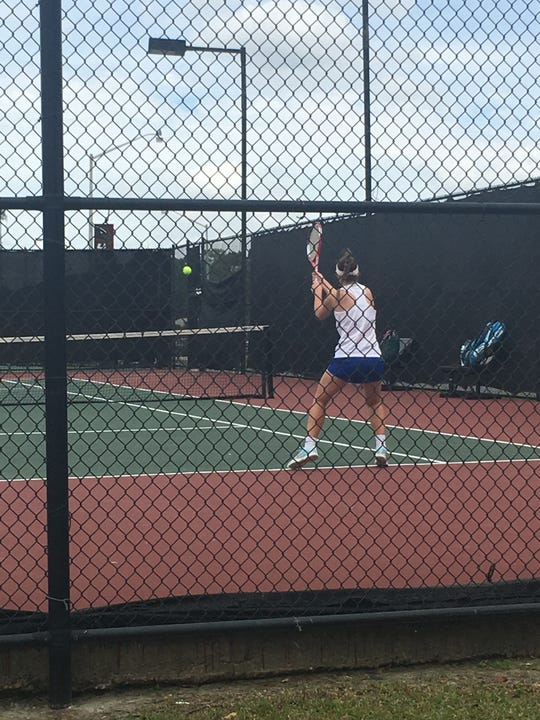 St. Mary's Emily Maggio returns a serve during the LHSAA state tennis tournament.