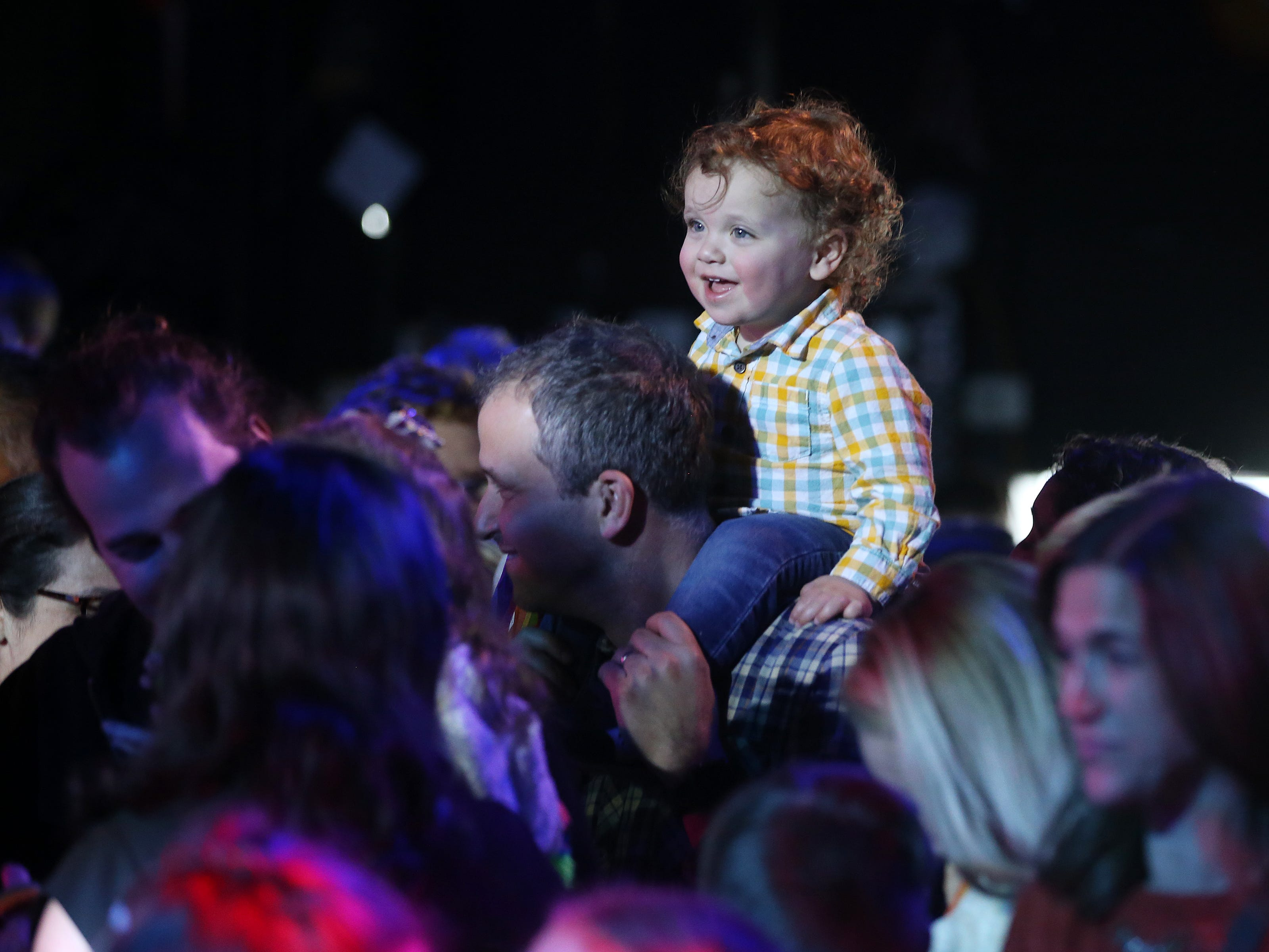 Scott Warren of Jersey City dances with his 2-year-old son, Ezra, as the Rock and Roll Playhouse presents the Music of Bruce Springsteen for Kids at the Stone Pony during the Asbury Park Music and Film Festival in Asbury Park, NJ Sunday, April 28, 2019.  #APMFF