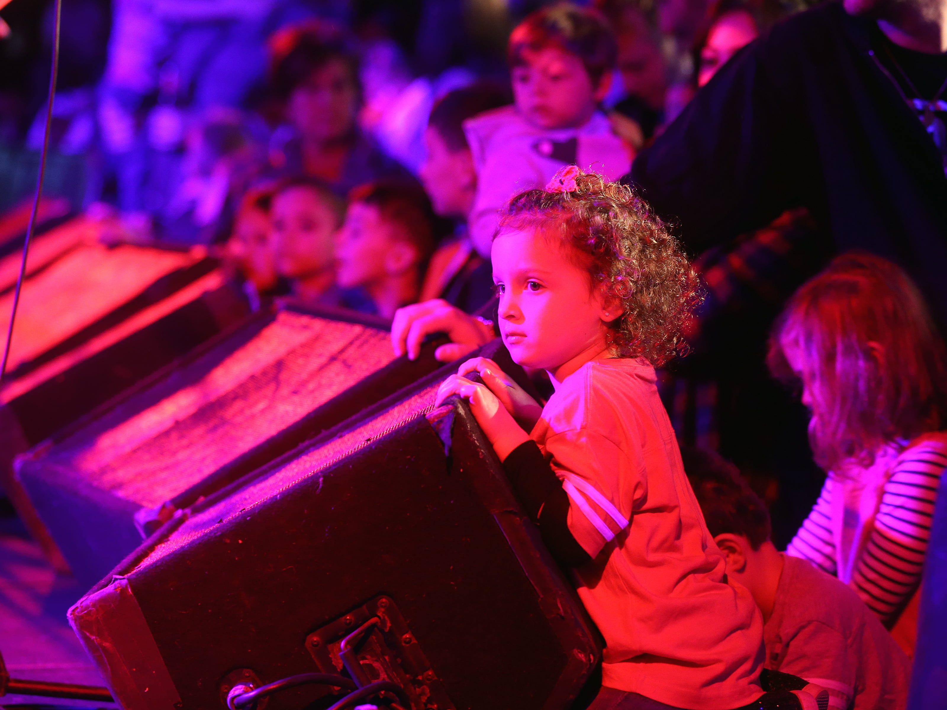 Charlie Ciaccio, 4, of Freehold Twp. sits on stage as the Rock and Roll Playhouse presents the Music of Bruce Springsteen for Kids at the Stone Pony during the Asbury Park Music and Film Festival in Asbury Park, NJ Sunday, April 28, 2019.  #APMFF