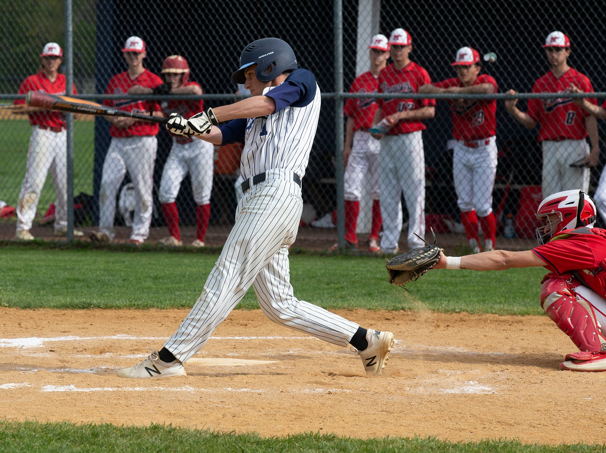 CBA's Anthony Celestre drives in Declan Hoverter for his team's first run of game. Manalapan baseball vs Christian Brothers Academy in Middletown NJ. On May 2, 2019.