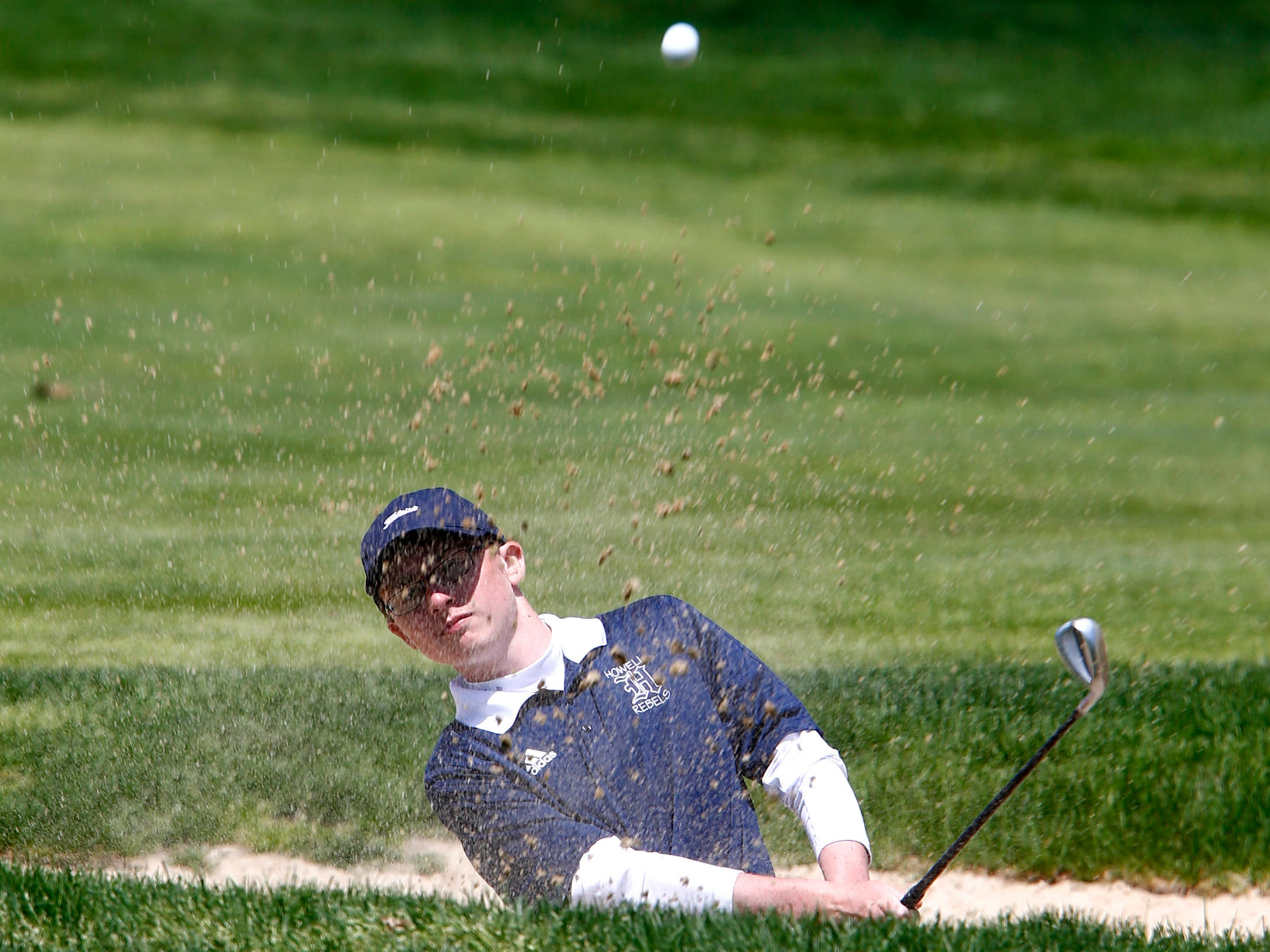 Howell's Travis Dix hits out of the sand on the 14th hole during the Boys Shore Conference Tournament at Charleston Springs Golf Course in Millstone Monday, April 29, 2019.