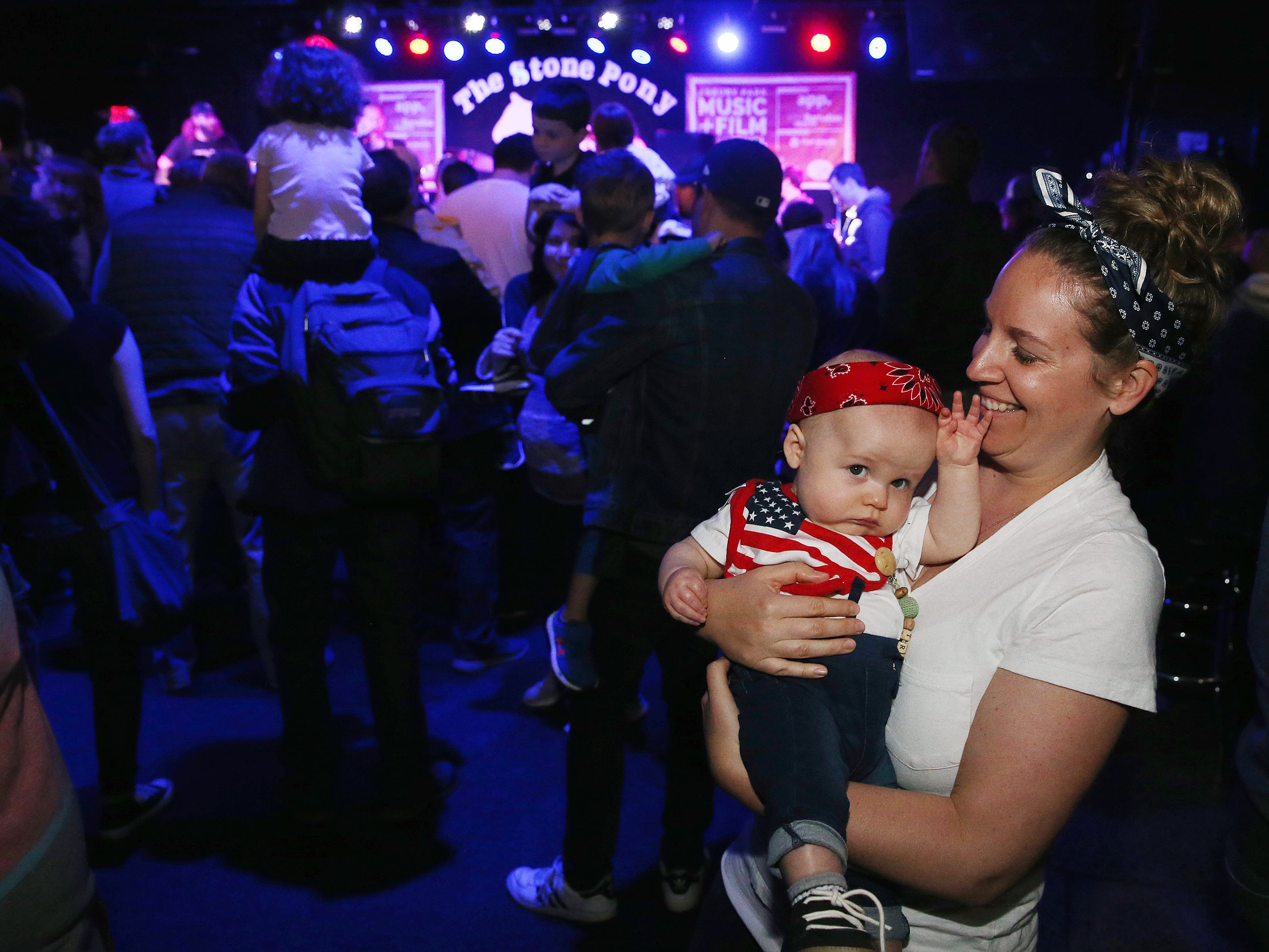 Dressed as Bruce Springsteen, Travis Stonaker, 7-months, of Ocean Twp. dances with his mother, Christina Stonaker, as the Rock and Roll Playhouse presents the Music of Bruce Springsteen for Kids at the Stone Pony during the Asbury Park Music and Film Festival in Asbury Park, NJ Sunday, April 28, 2019.  #APMFF