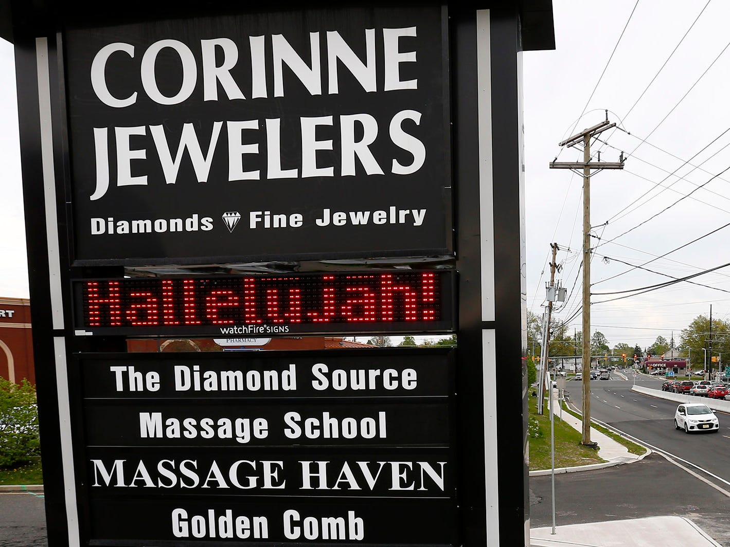 The sign outside Corinne Jewelers on Route 166 heralds the long delayed reopening of the roadway in front of their Toms River business Friday, April 26, 2019.