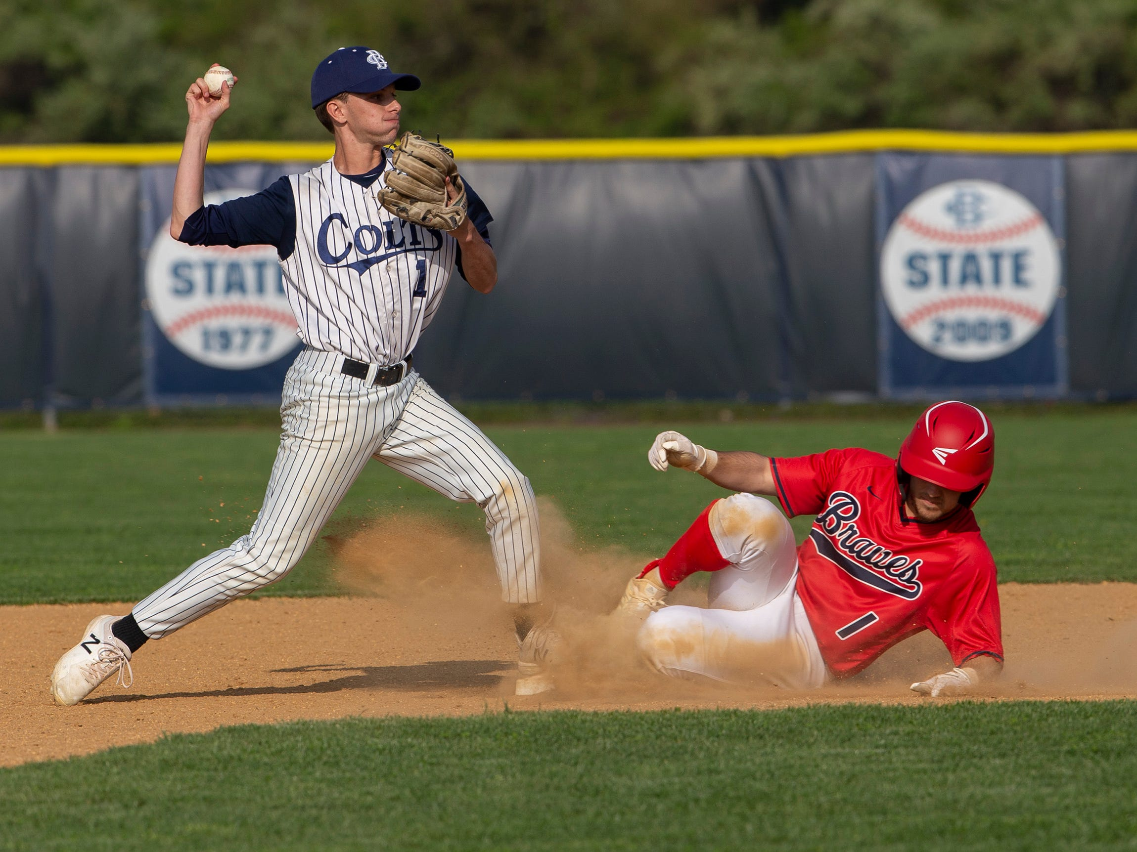 Mike Kuver of Manalapan breaks up a double play try by CBA Anthony Celestre in the sixth inning. Manalapan baseball vs Christian Brothers Academy in Middletown NJ. On May 2, 2019.