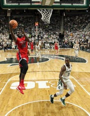 Stony Brook's Akwasi Yeboah (15) lays the ball up against Michigan State Spartans guard Lourawls Nairn Jr. (11) in 2017