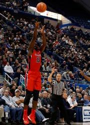 Stony Brook's Akwasi Yeboah (15) shoots against UConn in 2017.