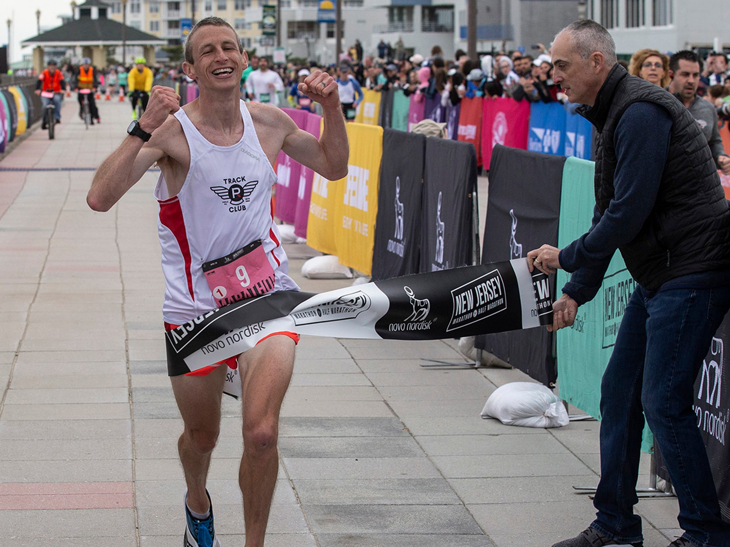 Sean Clark of Philadelphia finishes first in the Men's race at the 2019 Novo Nordisk New Jersey Marathon and Half Marathon which started at Monmouth Park in Oceanport and ended at Ocean Promenade in Long Branch.