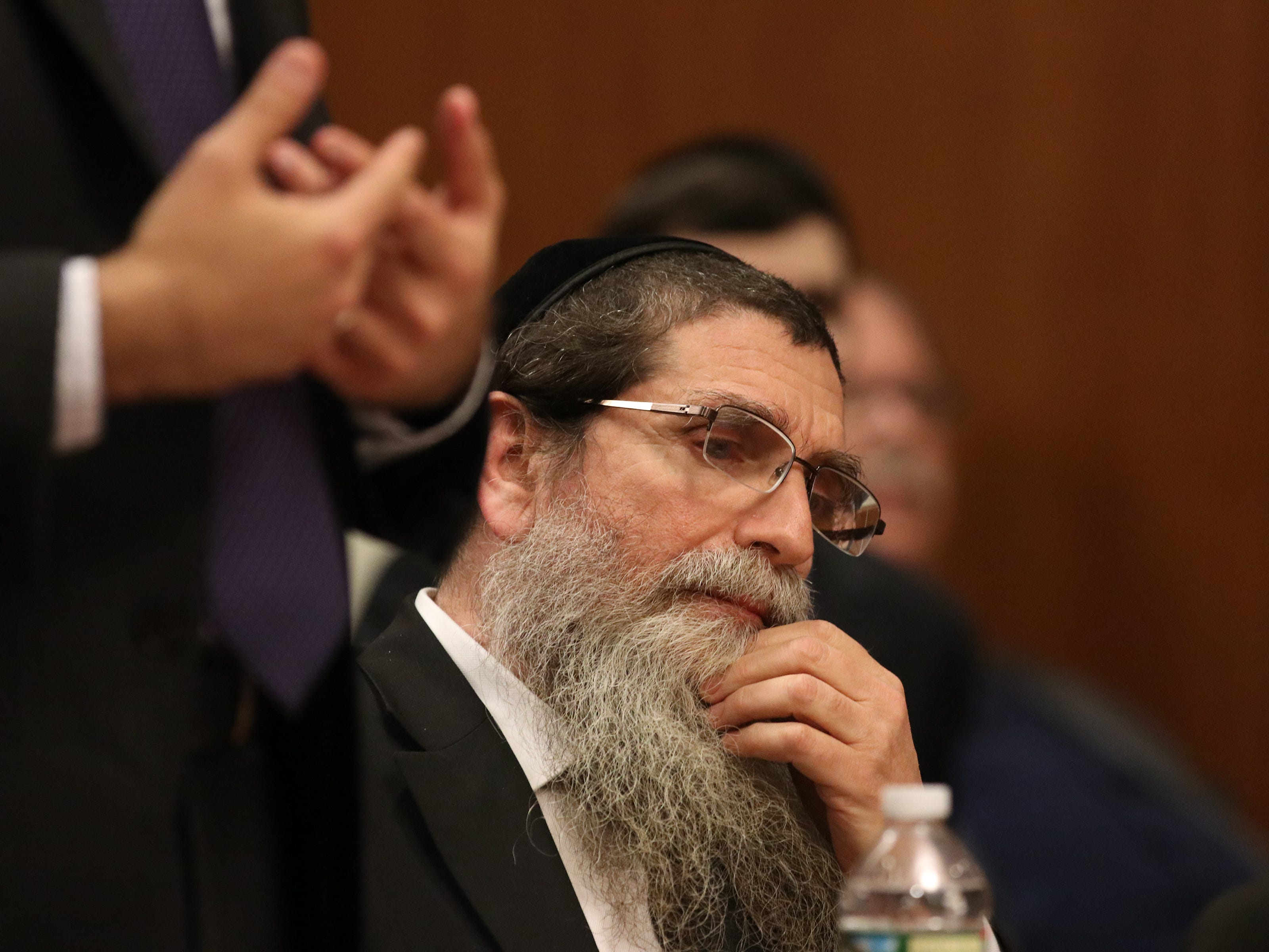 Rabbi Osher Eisemann, the founder of Lakewood special education school the School for Children with Hidden Intelligence who was found guilty of two criminal counts after a trial and faces prison time for the crimes, is sentenced before Judge Benjamin S. Bucca, Jr. at the Middlesex County Courthouse in New Brunswick,NJ Monday, April 29, 2019.