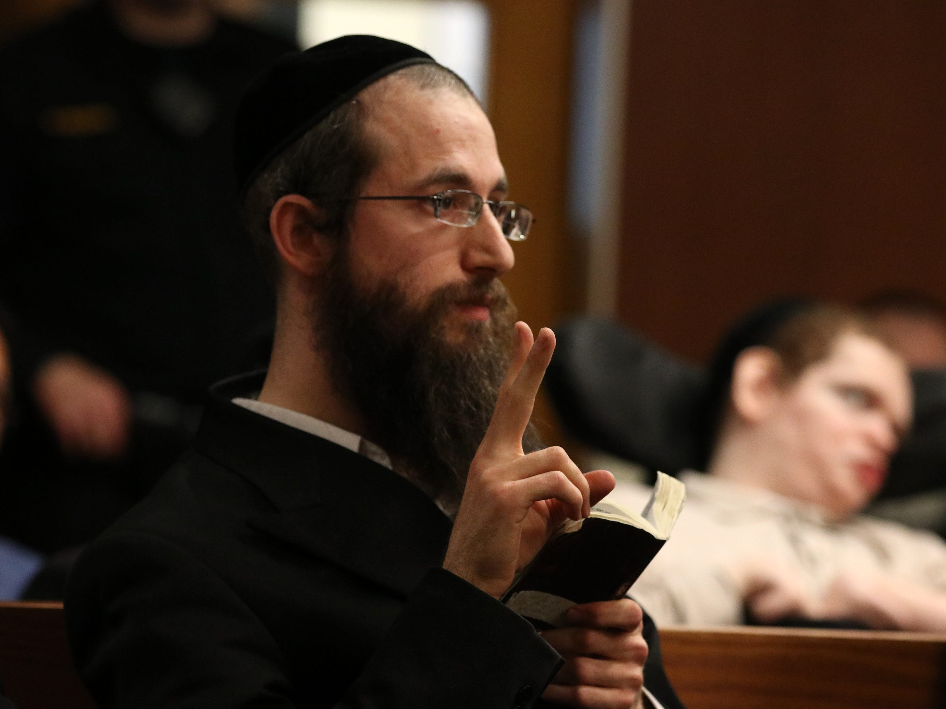 Supporters react as Rabbi Osher Eisemann, the founder of Lakewood special education school the School for Children with Hidden Intelligence who was found guilty of two criminal counts after a trial and faces prison time for the crimes, is sentenced before Judge Benjamin S. Bucca, Jr. at the Middlesex County Courthouse in New Brunswick,NJ Monday, April 29, 2019.