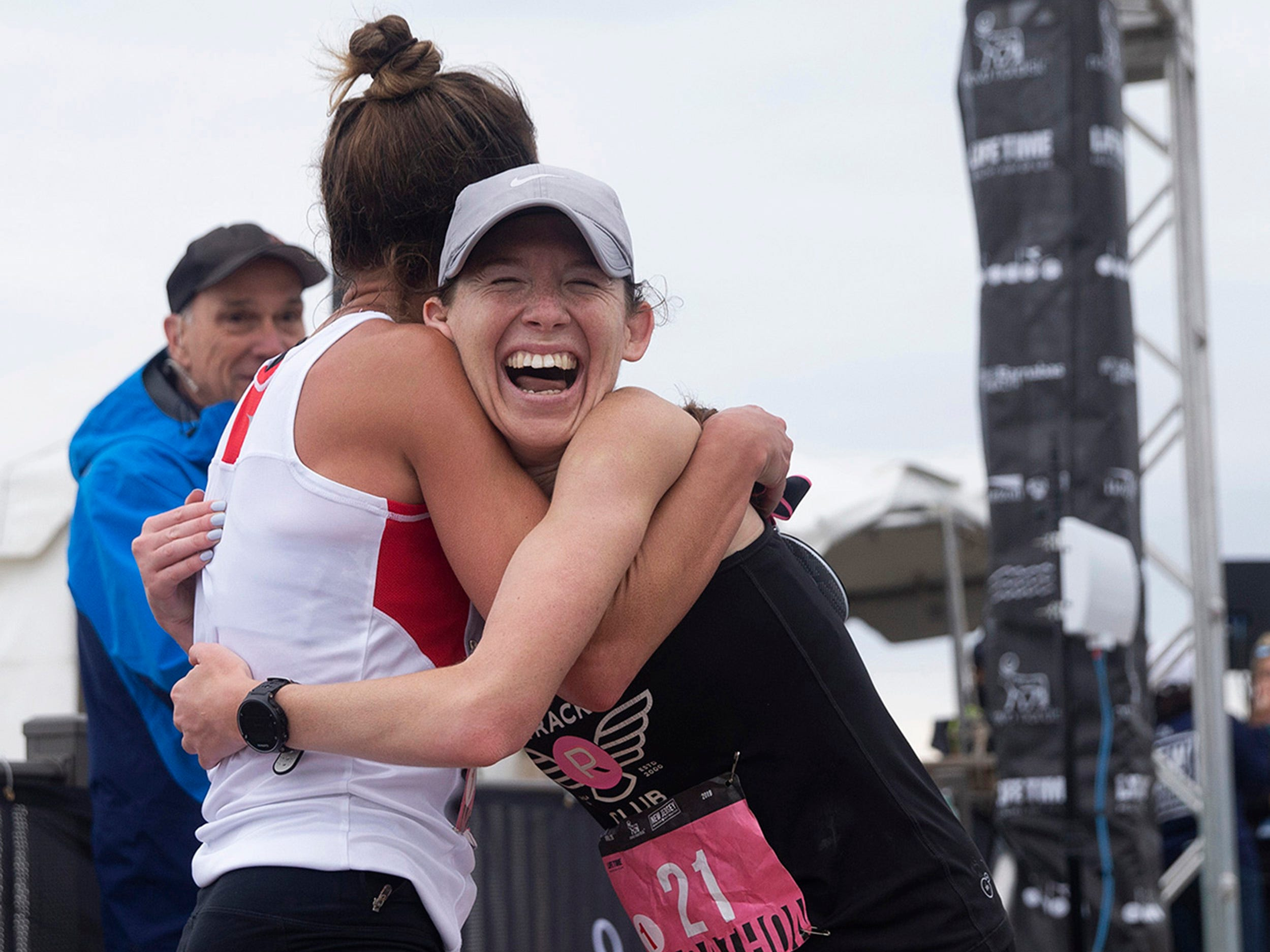 Kylie Pearse (right) gets a hug from women's winner Meghan Bishop at the finish line of the 2019 Novo Nordisk New Jersey Marathon and Half Marathon which started at Monmouth Park in Oceanport and ended at Ocean Promenade in Long Branch.